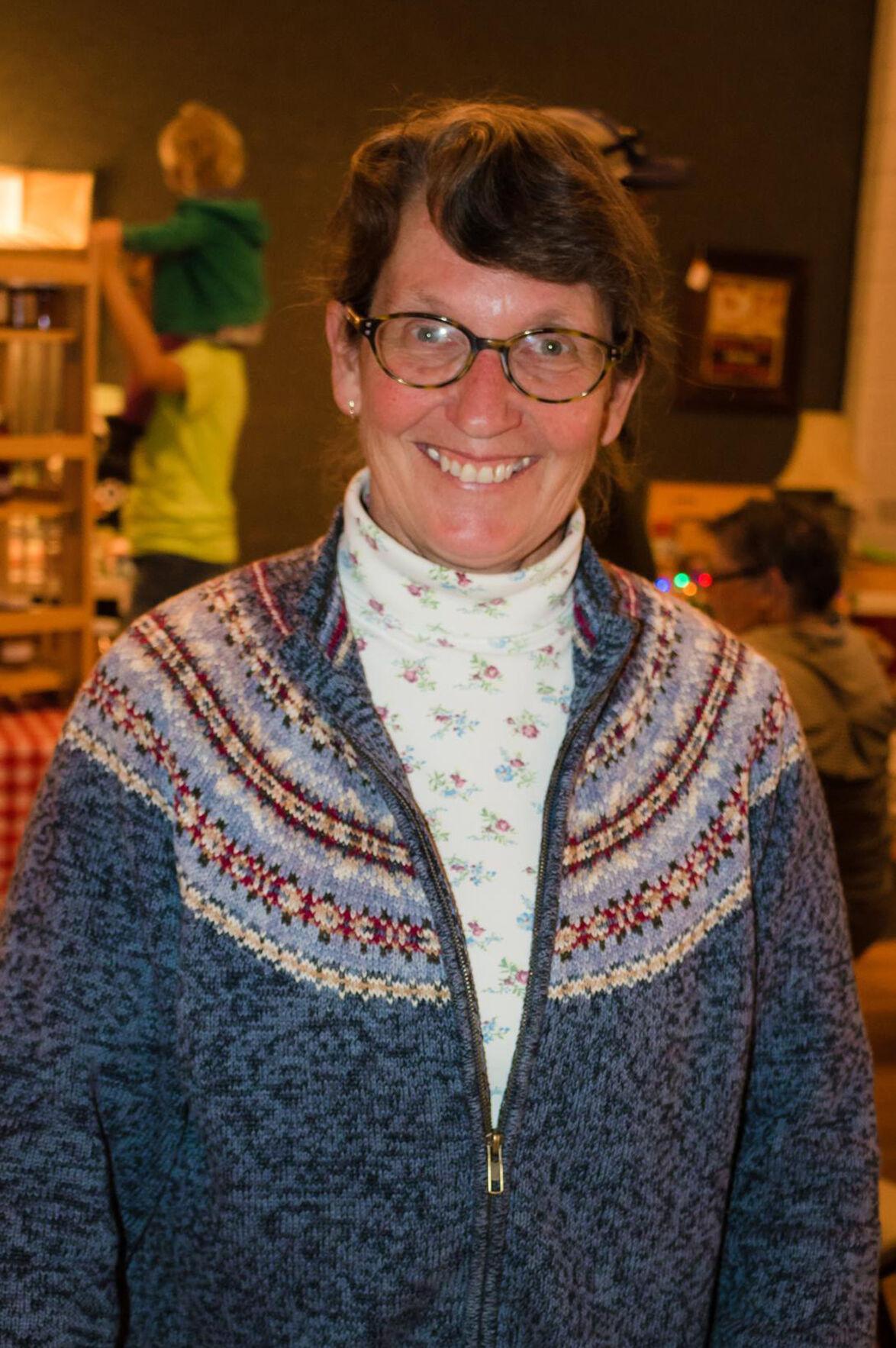 Rose Howe, blue sweater