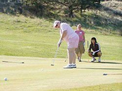 Golfers swing for breast cancer cure