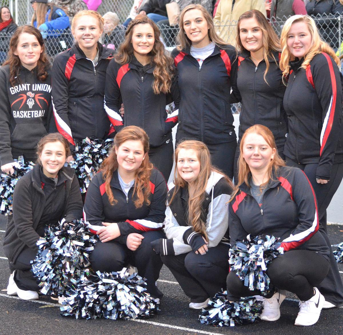 SCHOOL SPIRIT Cheerleaders rally around state contenders