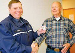 Retiree given badge of honor
