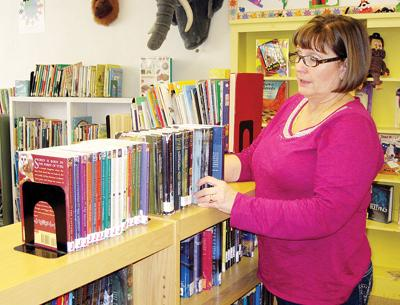 'Book angel' adds to library's shelves