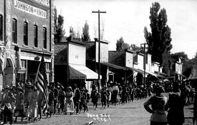 Parading down Main Street, John Day, 1910
