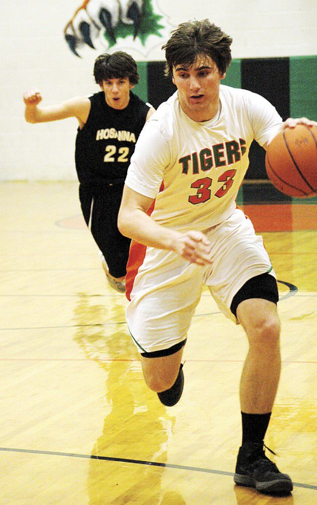 State playoff action: Tigers lose first state clash