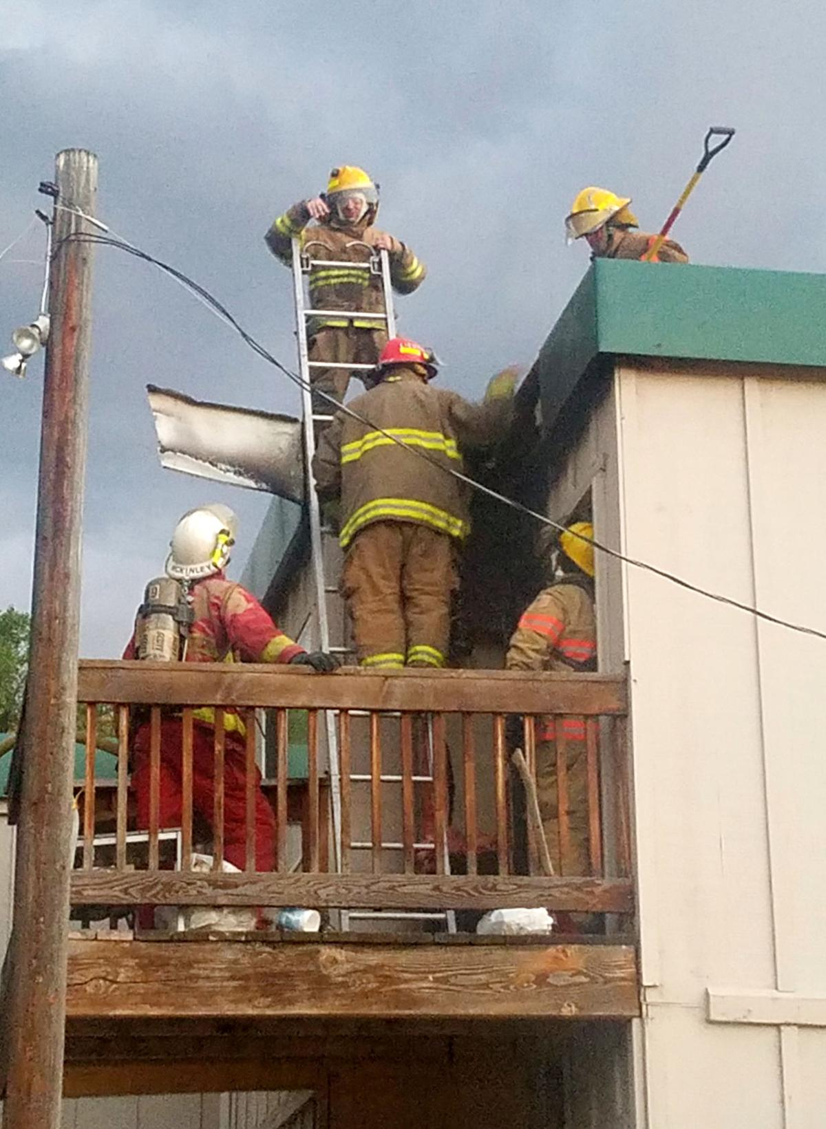 Crews keep apartment fire from spreading