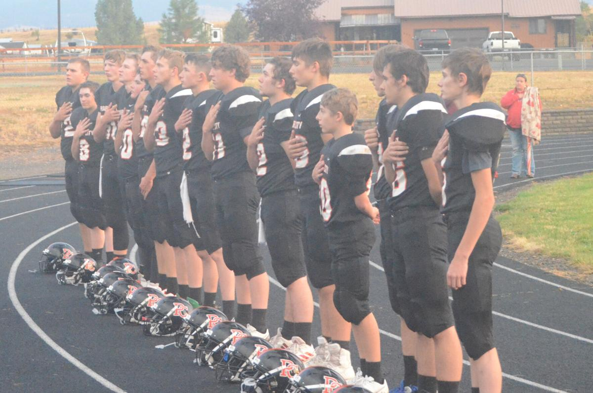 Panthers stand at attention for the National Anthem