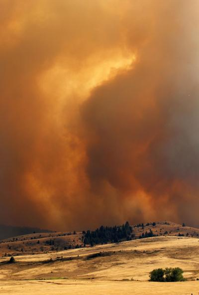 Rare wind storm threatens to push fire out of wilderness