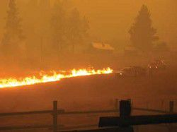 Monument fire grows, Seneca fire largely contained