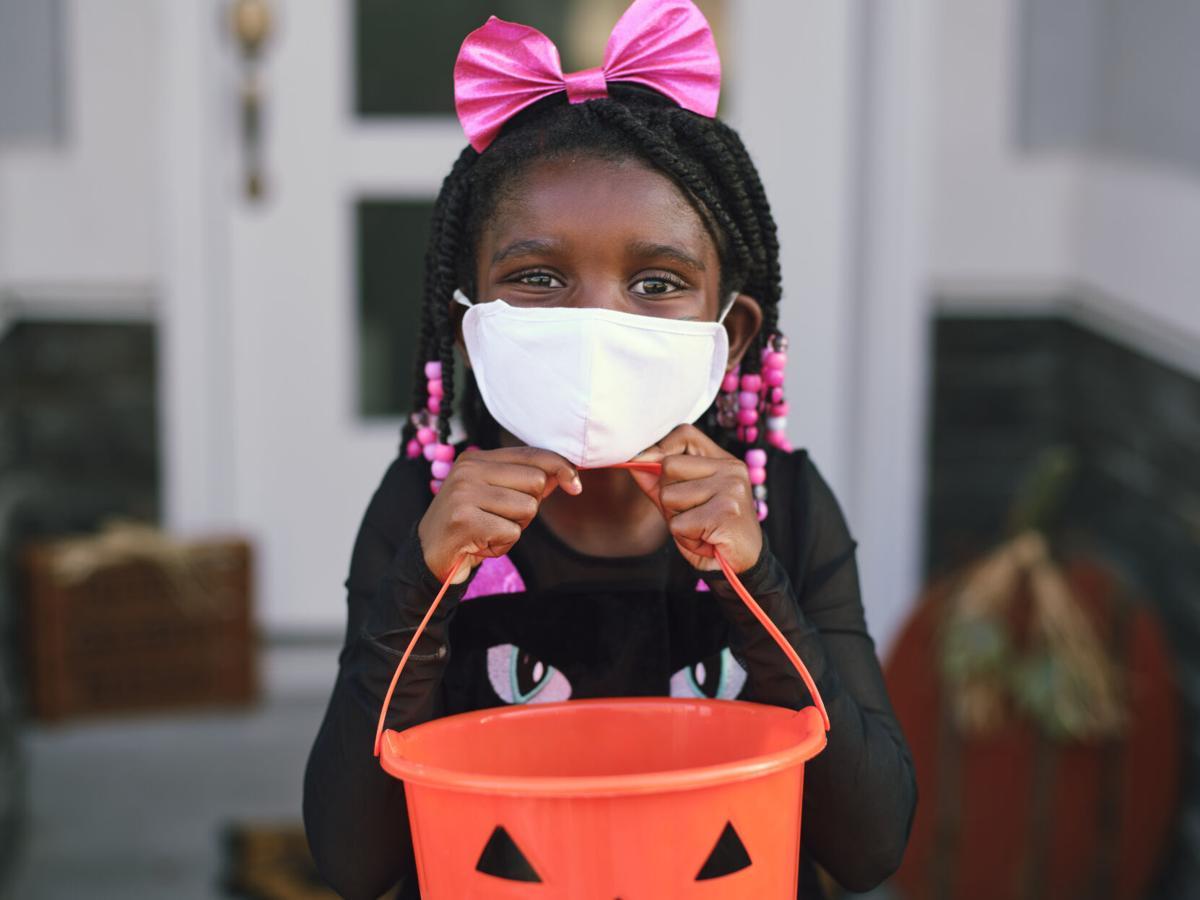 Halloween Children Trick or Treating Wearing Facemasks