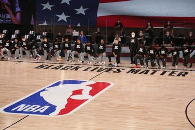 NBA players kneeling