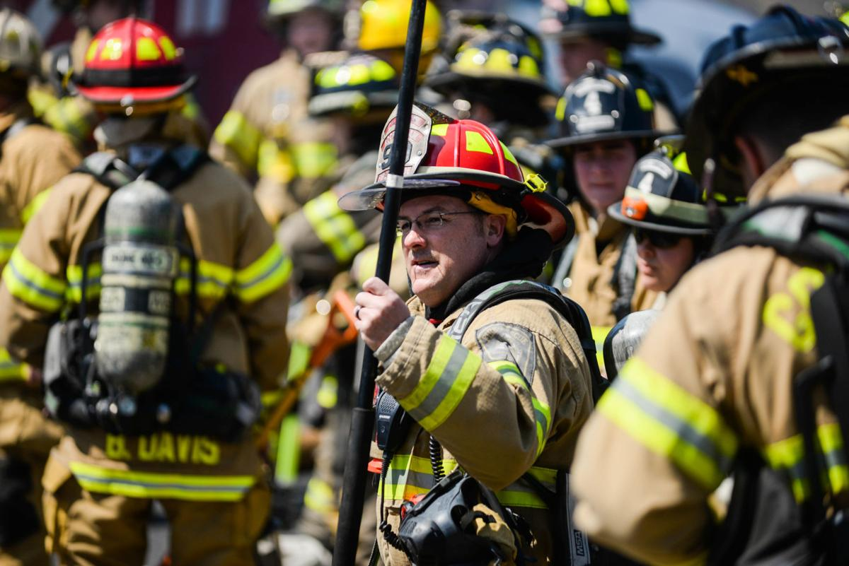 firefighter with long pole