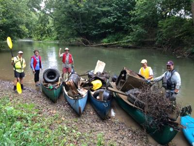Friends of the Middle River remove garbage from water