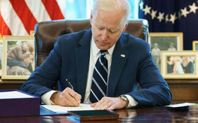 President Joe Biden Signs the American Rescue Plan Act on March 11, 2021