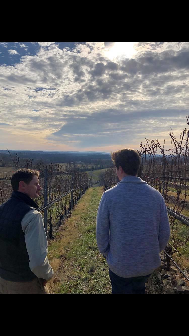 Clements with vineyard owner.jpg