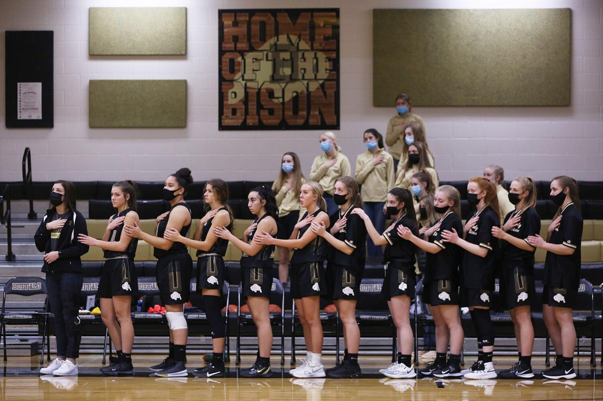Buffalo's varsity girls stand hooked together