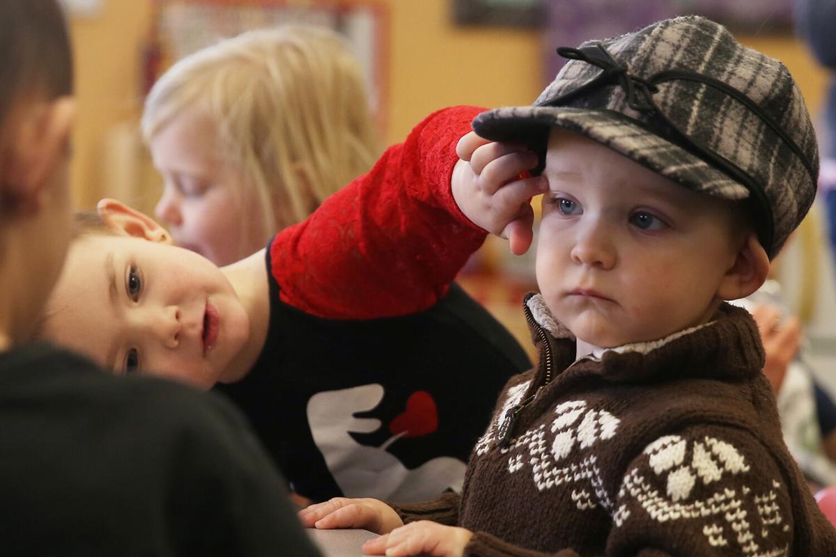 Brynlie Goodson, 4, rubs the cheeks of her brother Brayzen
