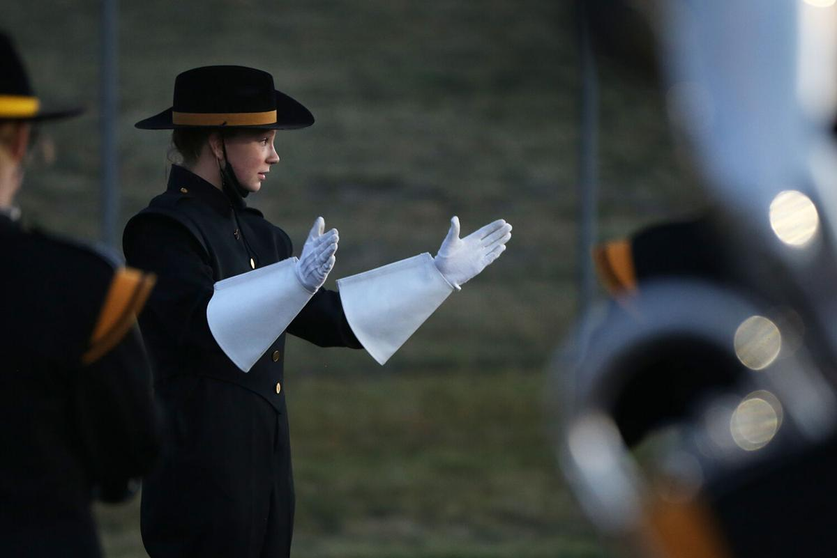 drum major Makenna Lambert works with fellow drum major Gabe Cahhal-Laudert to lead the band