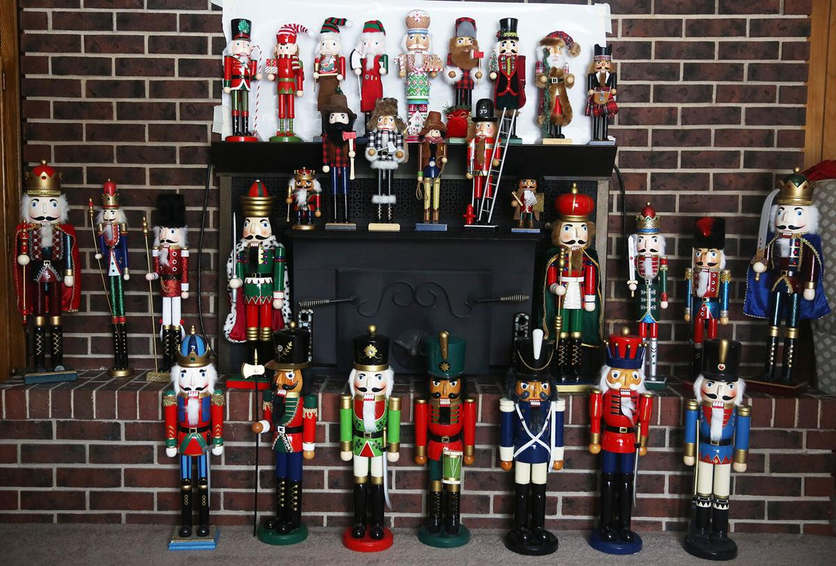 Forty two nutcrackers line the fireplace