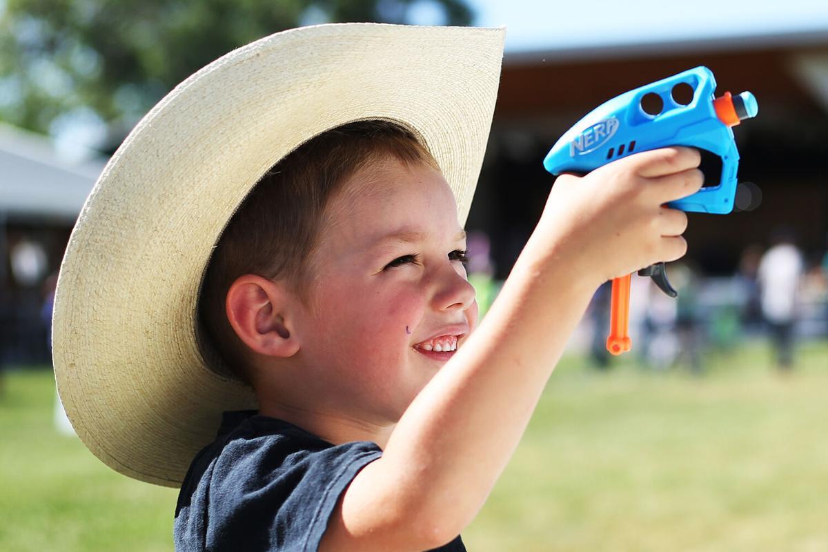 Samuel Hostetler, 5, squints his eye as he aims his nerf gun