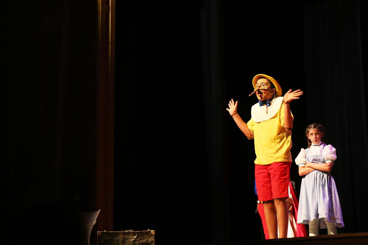 Pinocchio leads a song on stage