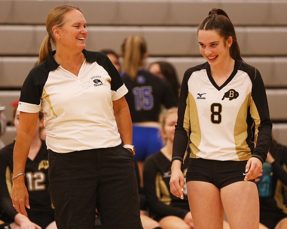 Michelle Dahlberg laughs with sophomore libero Cassidy Bessler before the start