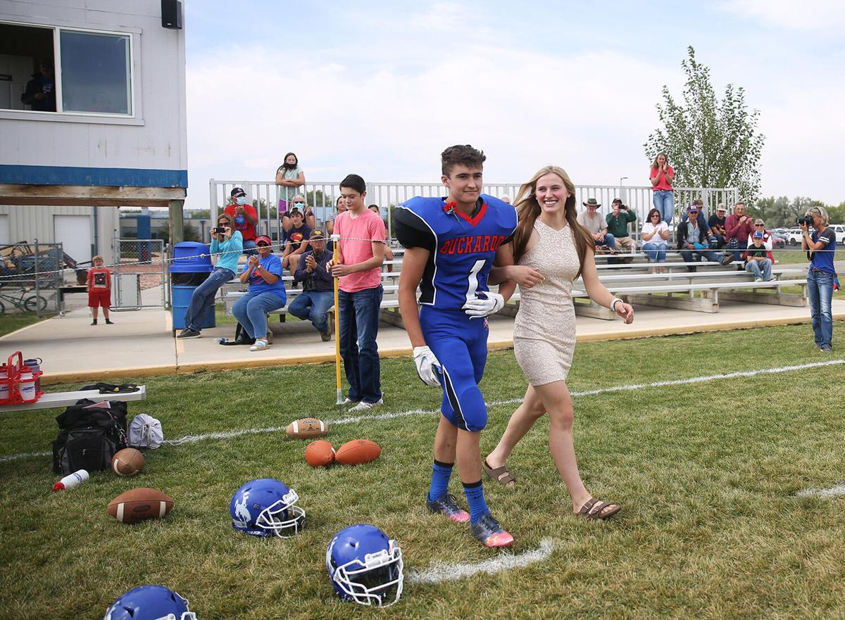 Dylan Fauber and Tinley Pierson walk onto the field