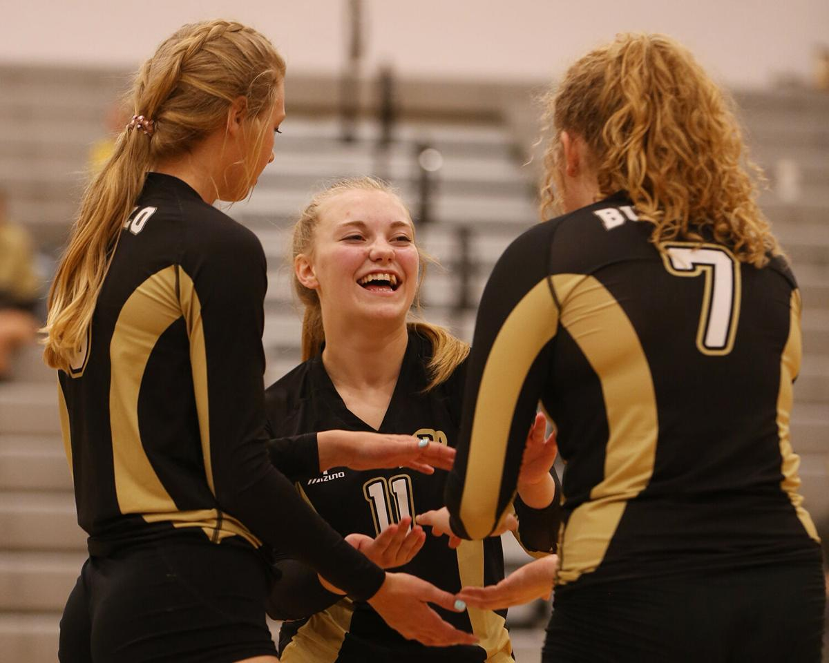 Cassie Downare laughs with her teammates Tessa Taylor and Anatefka Webber