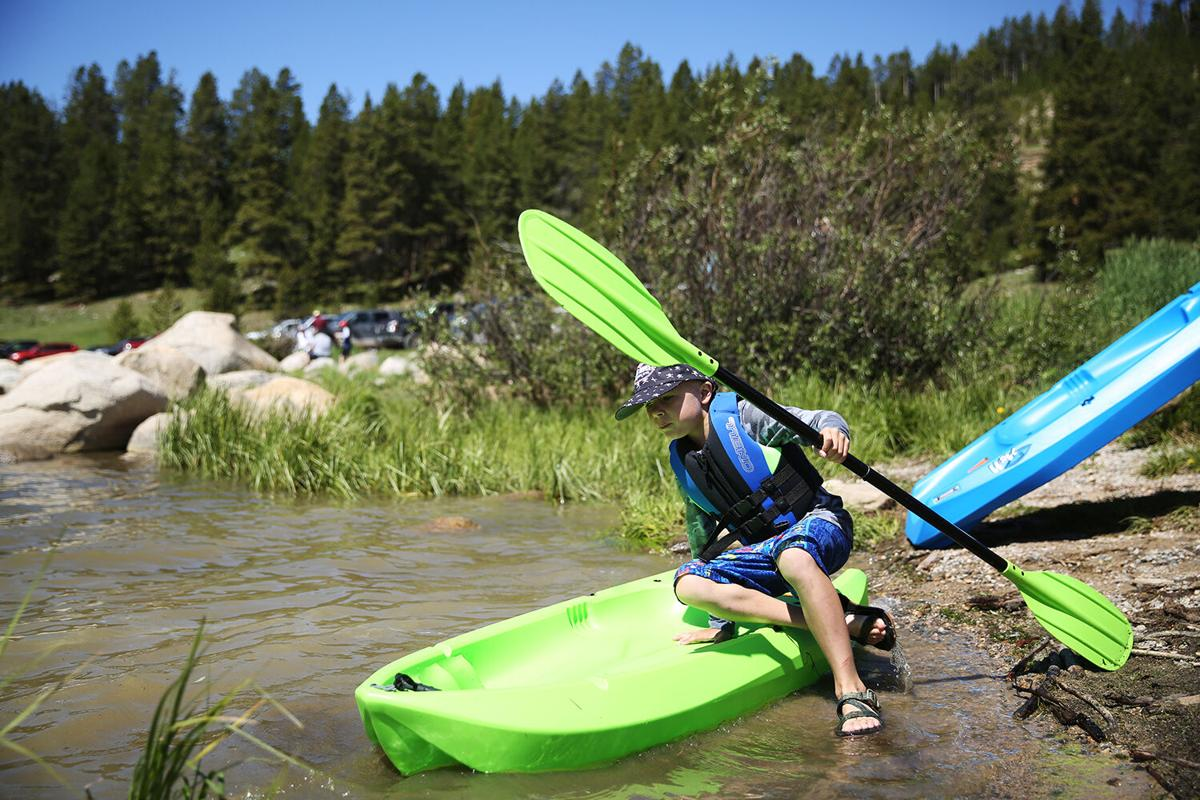 Jory Pierson balances his kayak as he climbs in on the edge