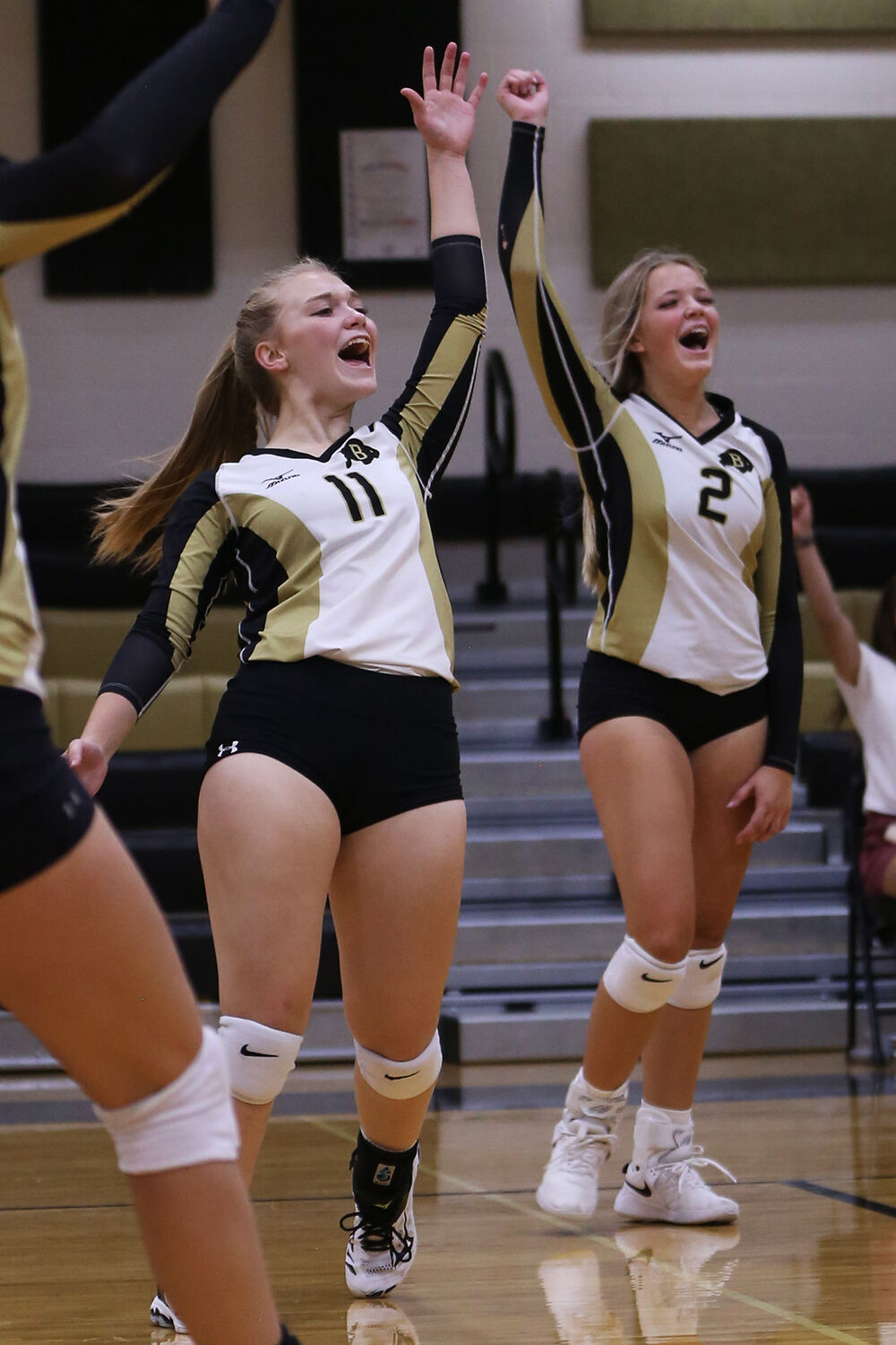 Cassie Downare and Holland Stowe throw their arms into the air
