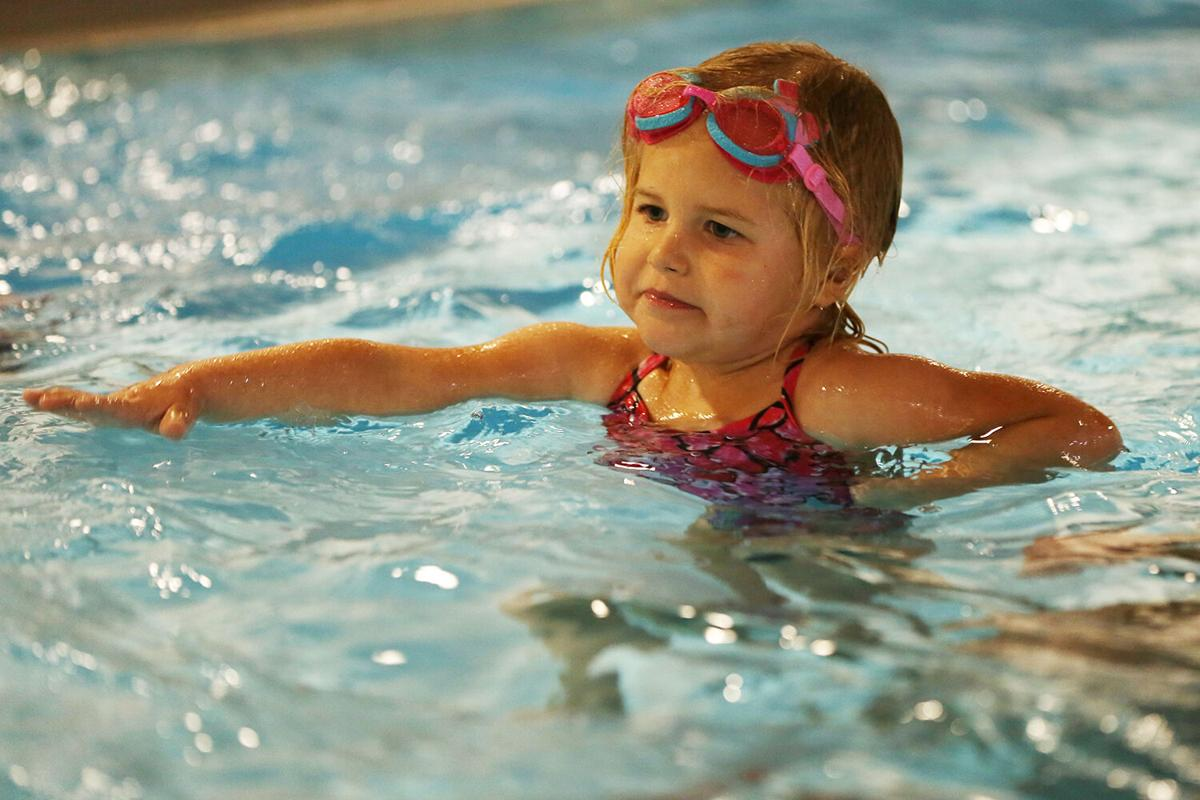 Marin Pierson, 3, practices her monster arms at the very beginning of her swim lesson