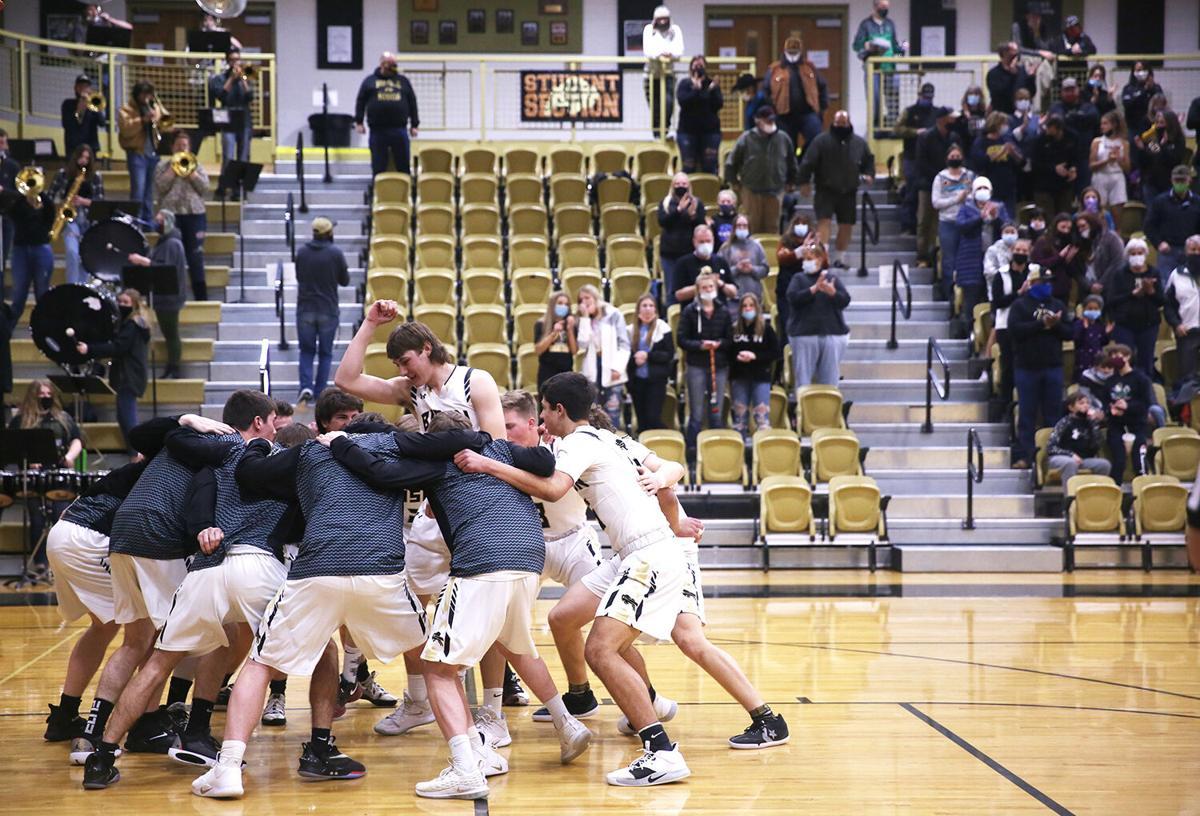 Buffalo's varsity boys basketball team huddles on court