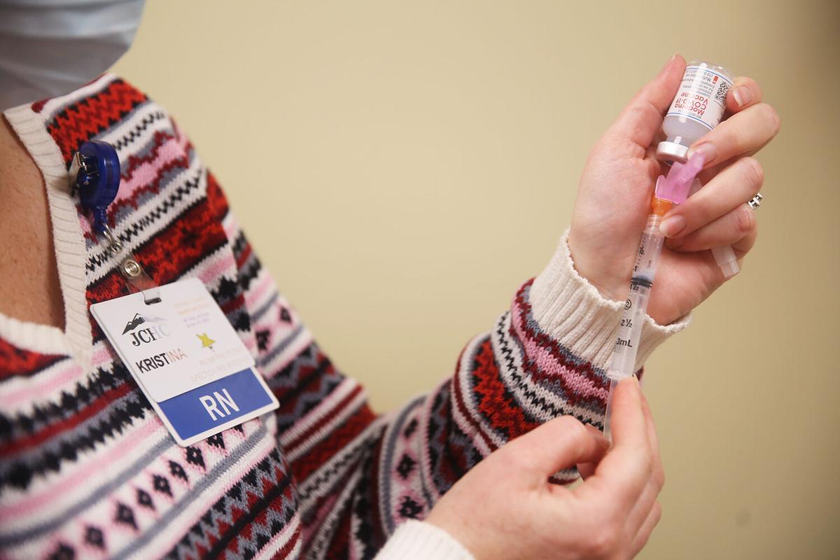 Kristina Duarte draws the Moderna COVID-19 vaccine