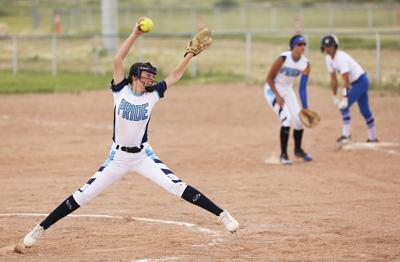 Buffalo's starting pitcher Taylin Hatch stretches forward before releasing her pitch