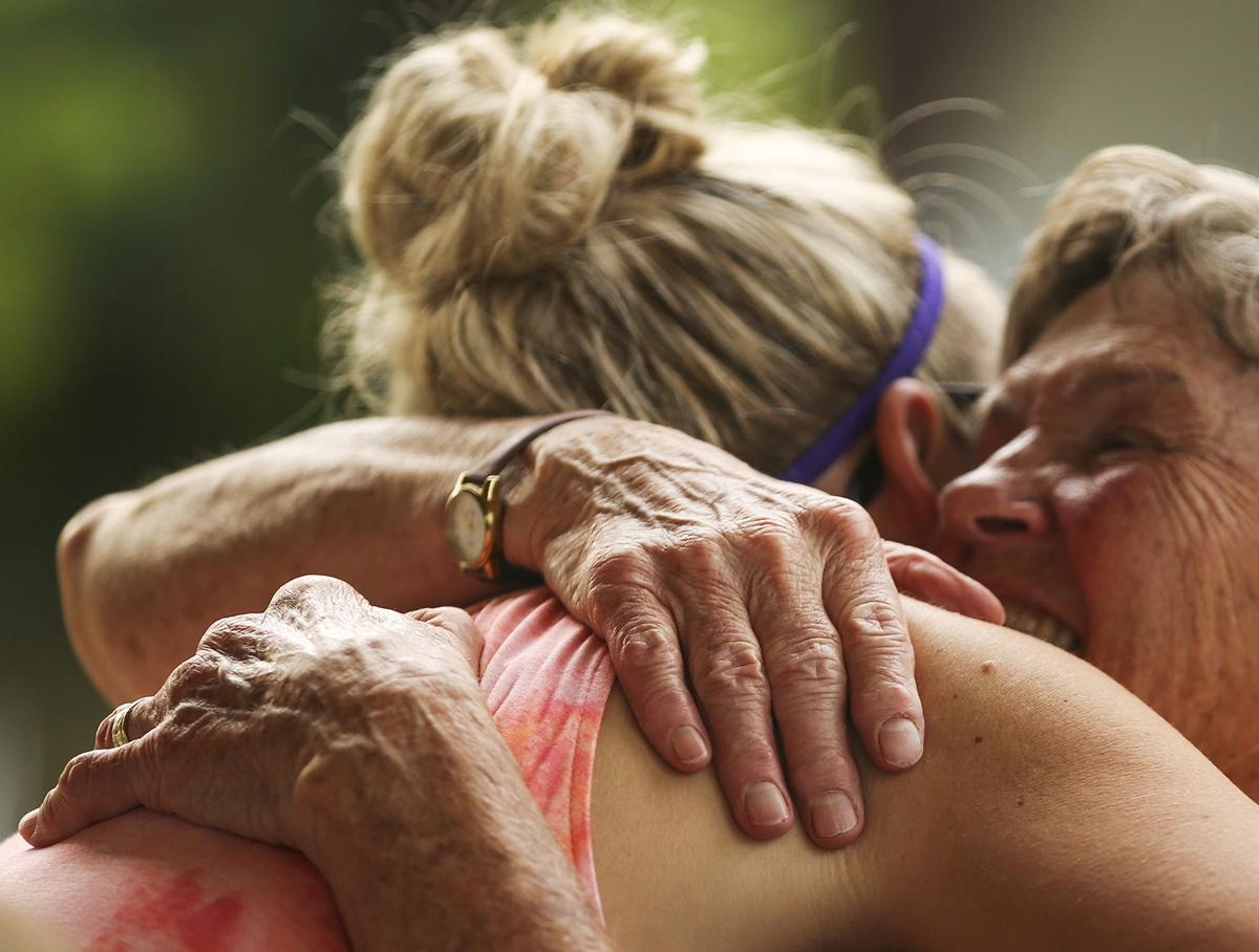 Linda Metzer hugs Cara Culliton during the picnic event that closed out the MOBs year