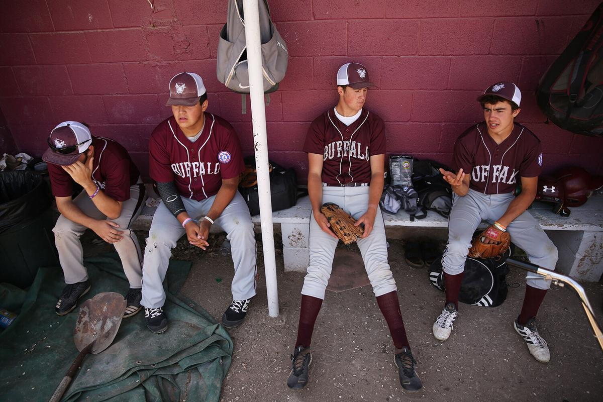 Cody Winters, Steven McGee, Ole Wagner and Joe Musselman relax in the shade