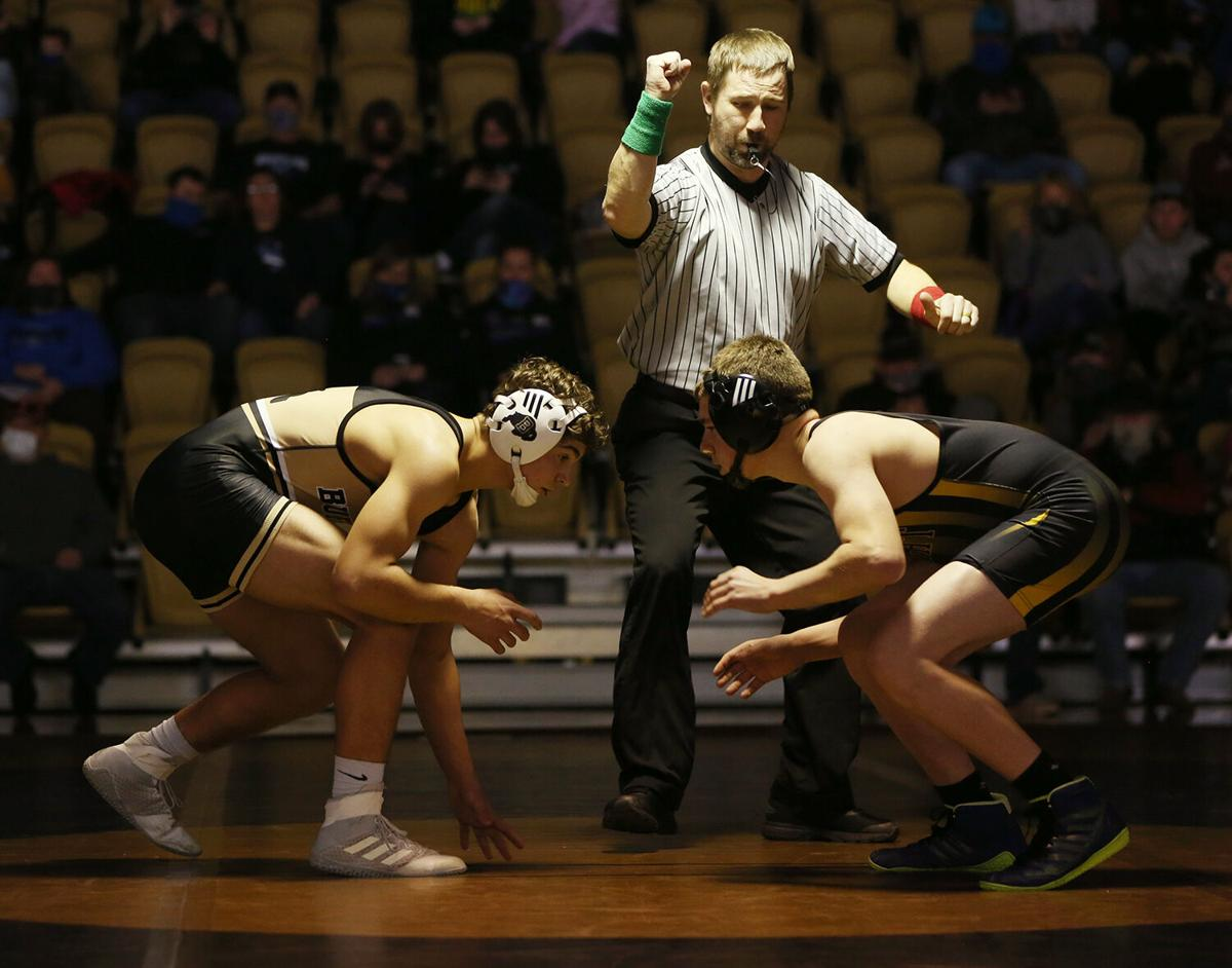 Hazen Camino lines up against Wright opponent Tadlee Isenberger before the start of their match