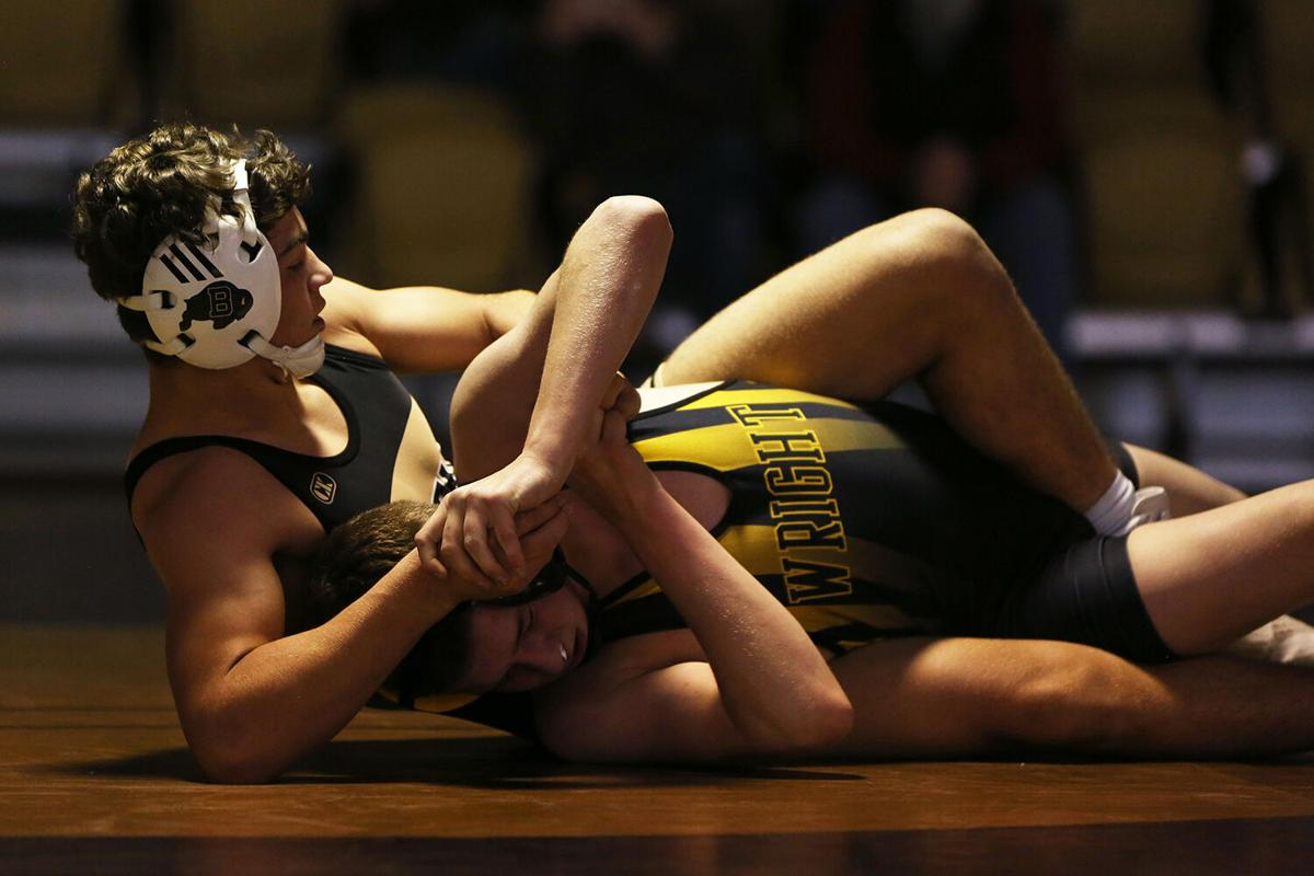 Hazen Camino pulls his Wright opponent Tadlee Isenberger in an attempt to pin him