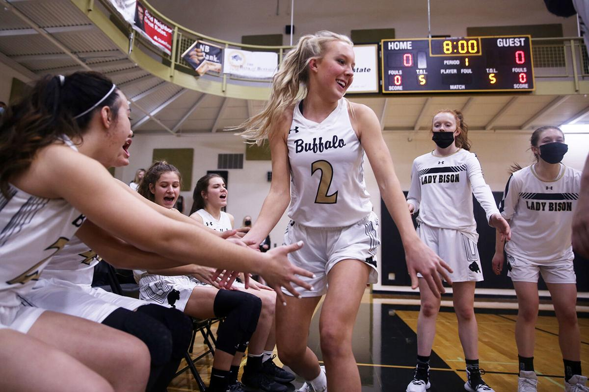 Kendall Tietjen high fives her teammates