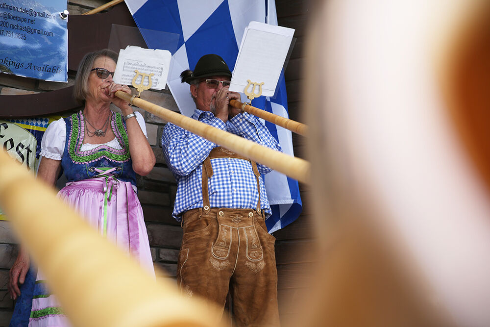 Kerry and Dale Hoffmann perform on their Alphorns beside fellow players