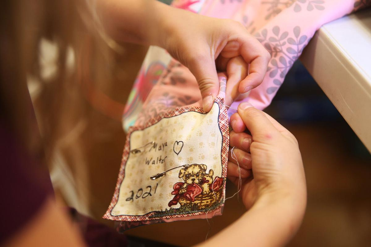 Maya Walter practiced her hand sewing by attaching her name label