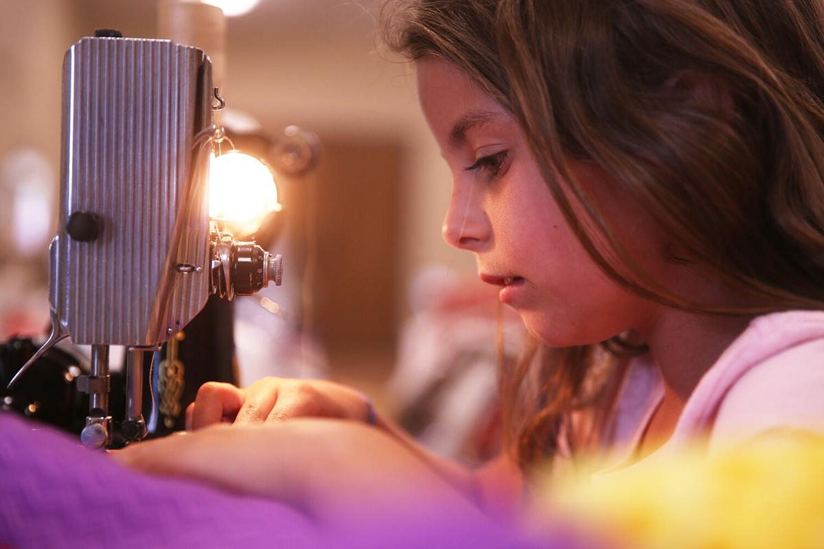 Brooke Chapman, 8, attentively watches her seem lines
