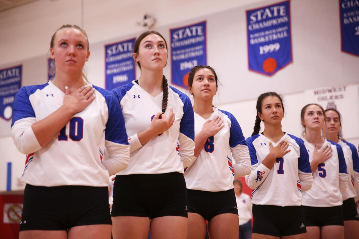 Kaycee High School varsity volleyball lined up for the singing of the national anthem