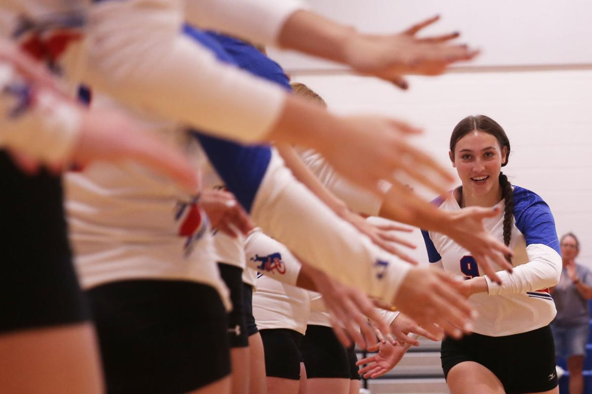Laci Taylor high fives her teammates