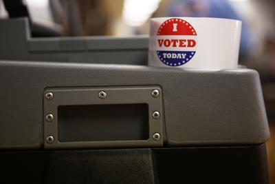 """A roll of the """"I Voted Today"""" stickers stayed atop one of the two new ballot machines"""