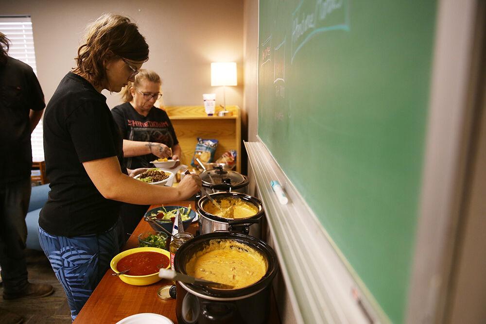 McKenzie Jacobson makes up a bowl of nachos