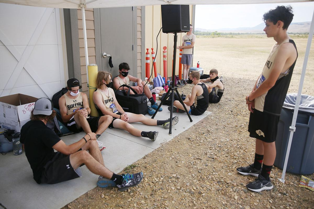Members of Buffalo High School's boys cross country team huddled in the shade