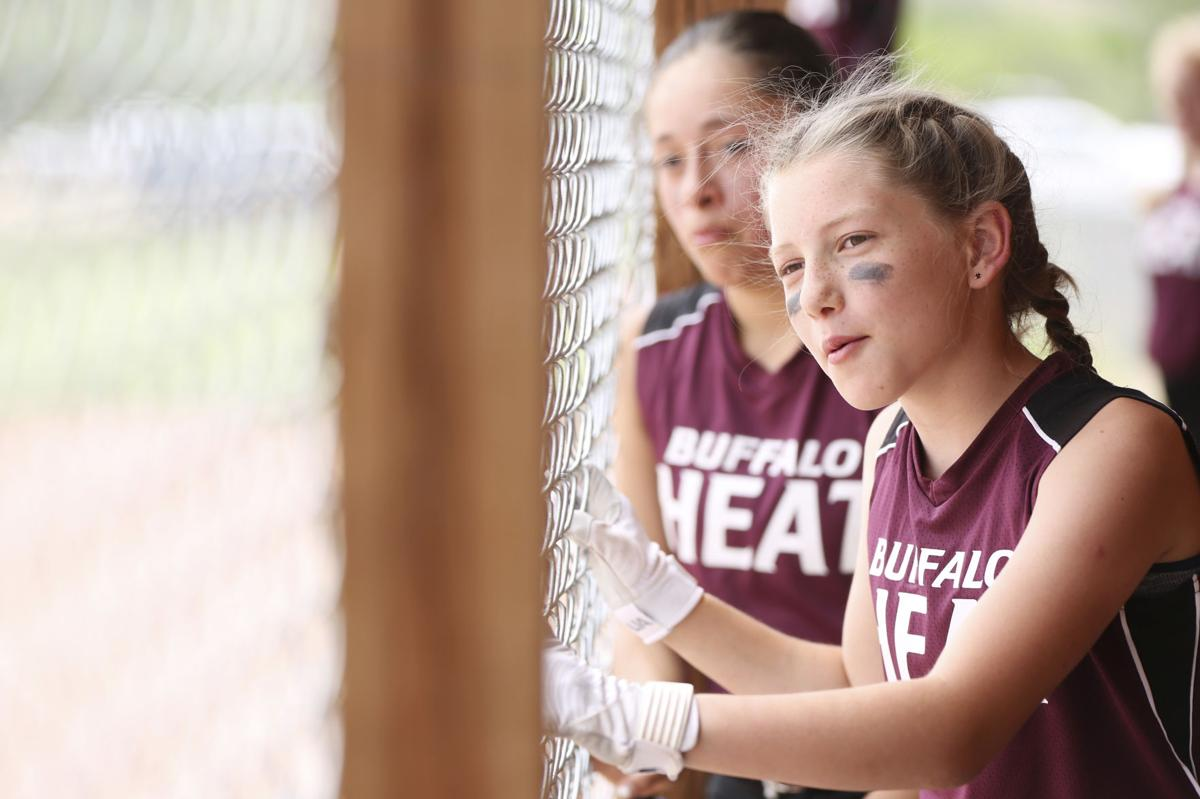 Ava Teten cheers for Buffalo's batter during the first inning of their scrimmage