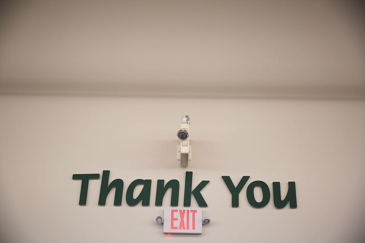 """The large """"Thank You"""" and """"Restrooms"""" signs"""