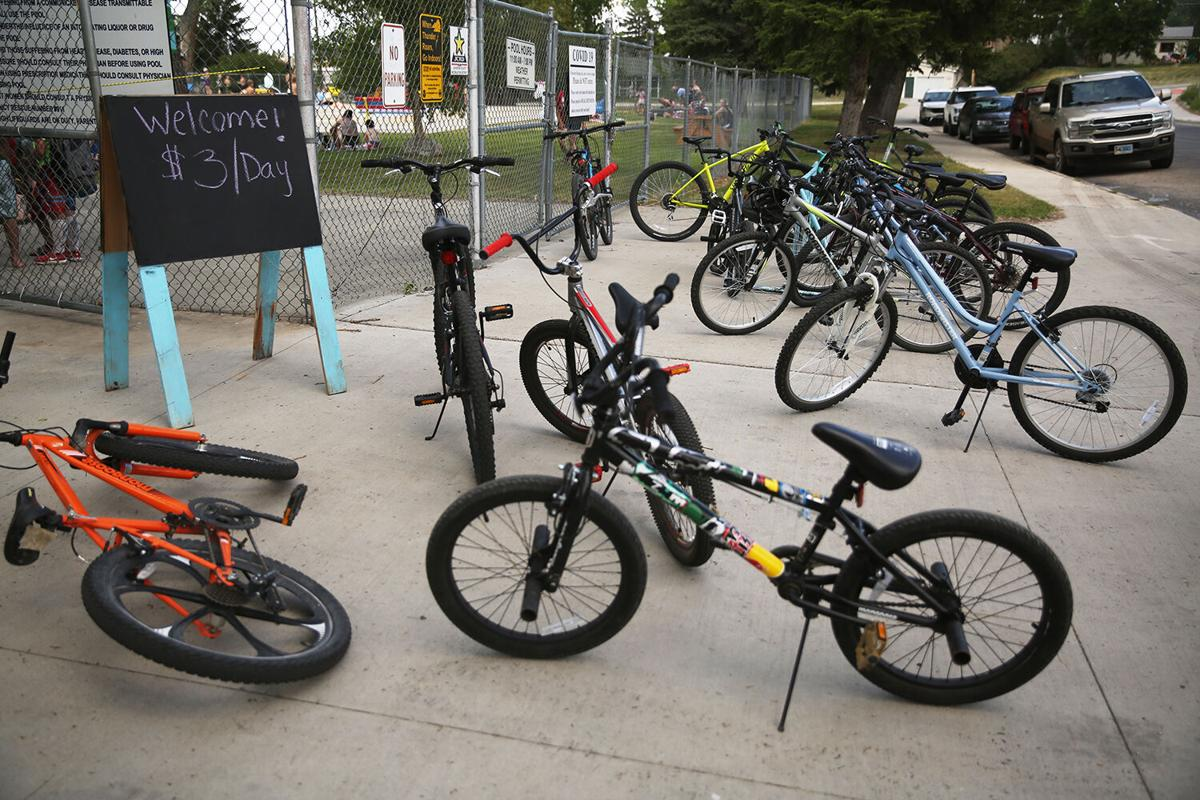 Bikes are scattered around the entrance to the pool