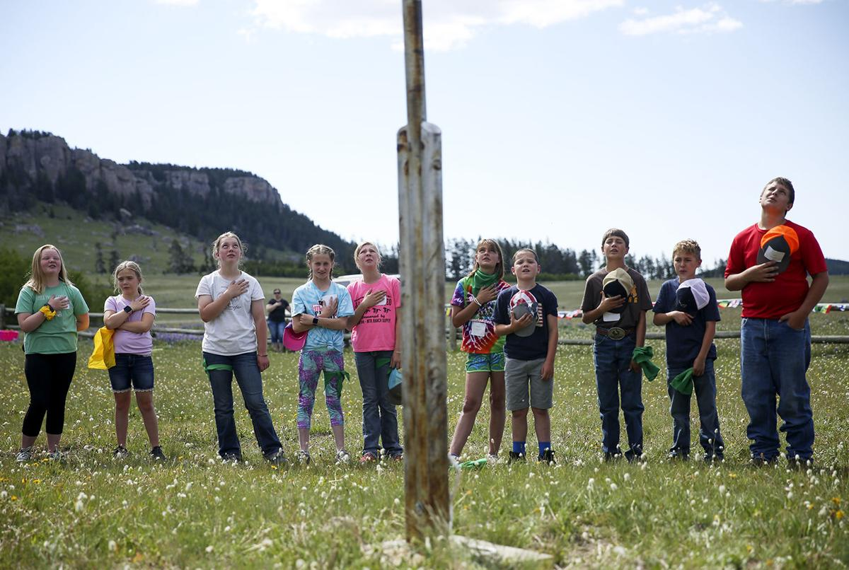 Johnson and Washakie counties 4-H members circle around the flagpole