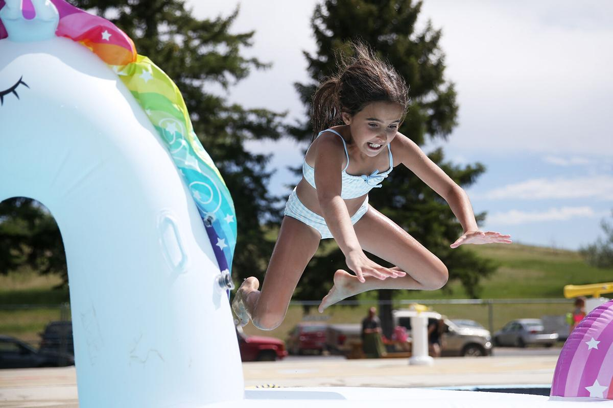 Harper Hancock, 10, leaps onto her blow up unicorn Patricia